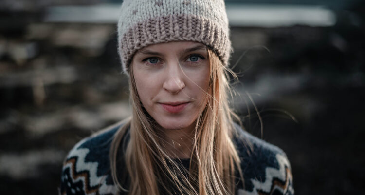 Portrait,Of,A,Young,Woman,Posing,In,Handmade,Knitted,Hat.
